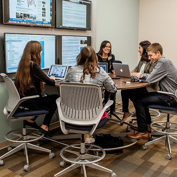 Six students working in a group study room