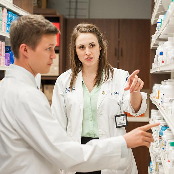 Two pharmacy students working in the campus pharmacy