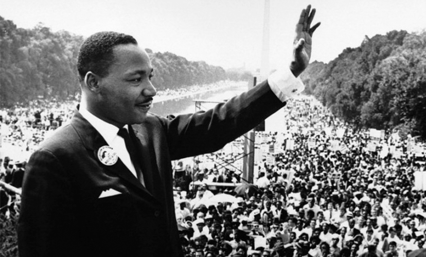Martin Luther King Jr. giving a speech in front of a large crowd
